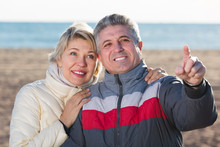 Couple Walk And Husband Points To Something