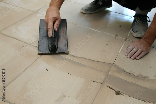 Grouting ceramic tiles, close up Wallpaper Mural