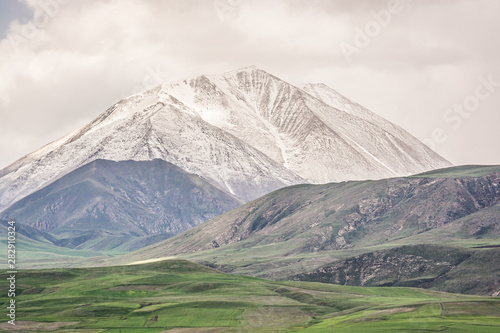 Mount Kose in Turkey near Agri with snow and green meadows Canvas Print