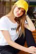 Beautiful blonde girl in a yellow cap and t-shirt