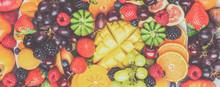 Healthy Fruit Platter Background, Strawberries Raspberries Oranges Plums Apples Kiwis Grapes Blueberries Mango Persimmon, Top View, Selective Focus. Long Photo Banner, Toned