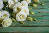 eustoma flowers on wooden background