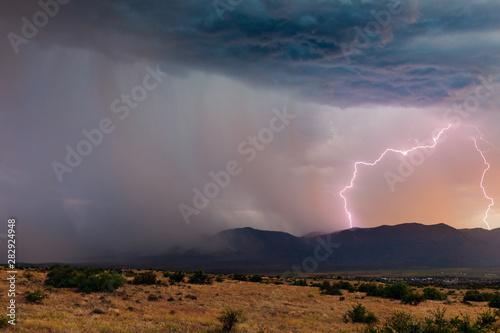 Fotografie, Obraz  Thunderstorm lightning at sunset