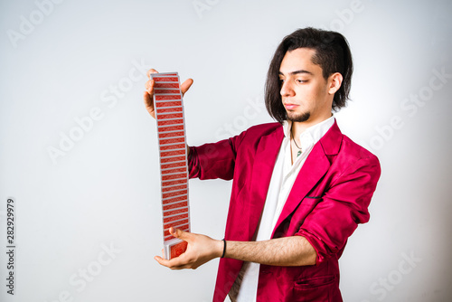 Fényképezés Magician shuffles a deck of cards, skill and dexterity to deceive his clients