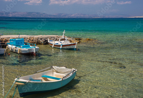 Deurstickers Australië Traditional fishing boats and the clear and blue waters of Mediterranean sea in the Saronic gulf, Greece.