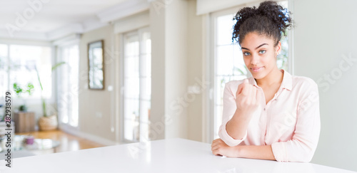 Wide angle of beautiful african american woman with afro hair Beckoning come her Wallpaper Mural