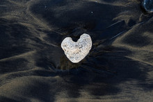 White Heart Shaped Stone On Bl...