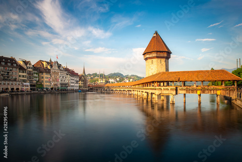Fotografie, Obraz Sunset in historic city center of Lucerne with famous Chapel Bridge and lake Lucerne in Canton of Lucerne, Switzerland