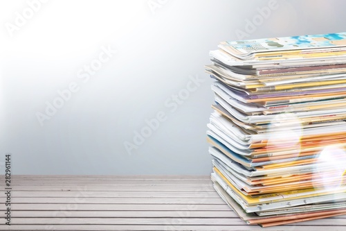 Photo Stands Asia Country Pile of newspapers on white background