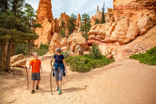 Senior Woman And Her Grandson Hiking Together In Bryce Canyon National Park, Utah, USA Looking Out At A Scenic View