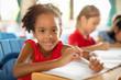 Smiling elementary school kids  in classroom