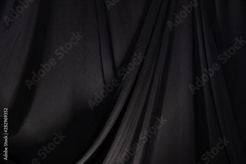 Cuadros en Lienzo  Black Curtain drape wave with studio lighting, Wallpaper Background Texture Deta