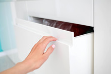 The Woman Hand Opens Modern Door White Kitchen With The Hidden Handle