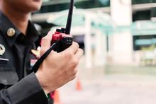 Security Guard Uses Radio Comm...