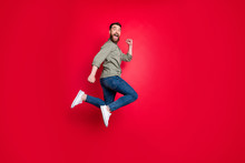 Full Length Body Photo Of Man Having Decided To Do Sport And Started Running While Isolated With Red Background