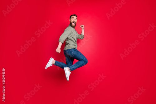 Cuadros en Lienzo Full length body photo of man having decided to do sport and started running whi