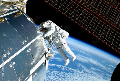 Tableau sur Toile The astronaut in an outer space, at the ISS, repairs and makes experiments