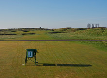 Looking Down The Par 4 Second Fairway From The Tee Box, With Golfers Walking Down The Fairway Having Played Their Shots. Carnoustie, Scotland.