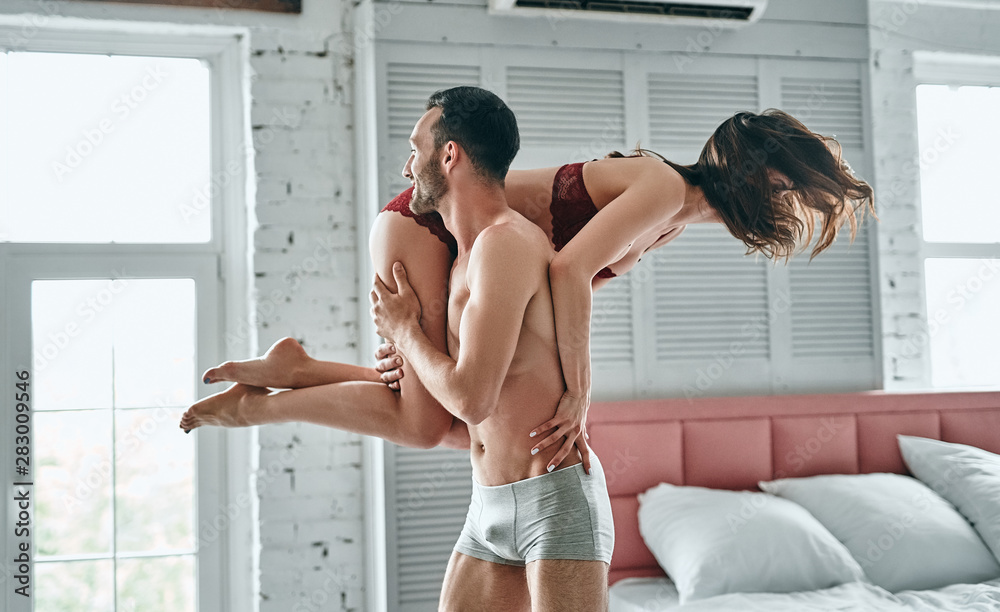 Fototapety, obrazy: The man carries a happy woman in the bedroom