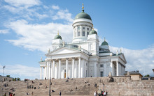 HELSINKI, FINLAND - JULY 27, 2019:  People On Stairs Of Helsinki Cathedral And Monument To Russian Emperor Alexander II In The Old Town Of Helsinki, Finland On The Senate Square.