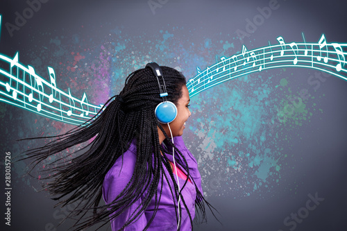 Girl listen music on headphones and dancing - 283035726