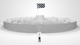 Man standing in front of a big round maze with flag - 283038375