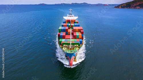 Cuadros en Lienzo  Aerial view container ship carrying container in import export business logistic and transportation of international by container ship in the open sea