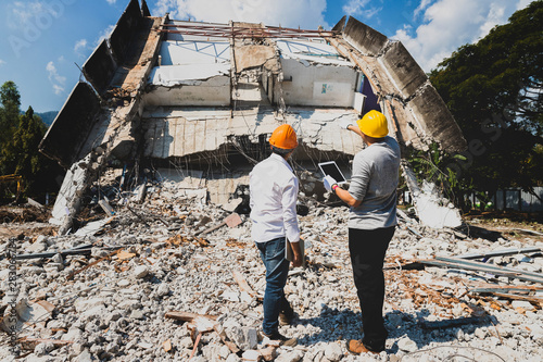 Canvas Print Demolition control supervisor and contractor discussing on demolish building