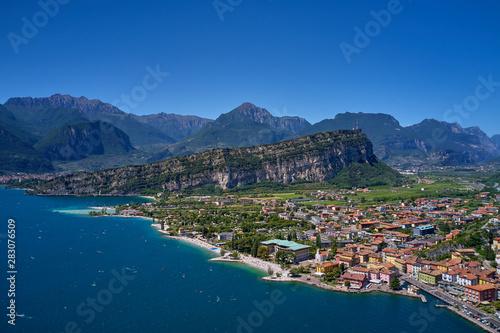 Aerial view of Lake Garda, mountains, cliffs and the city of Riva del Garda, Italy Fototapeta