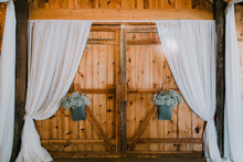 Barn Doors With White Fabric And Flowers Baby Breath, Wedding In Barn