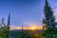 Sunrise Above Forest And Mountains