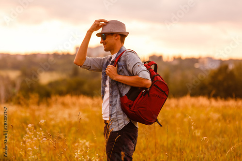 Fototapety, obrazy: Portrait Of Man Hiking In Countryside Wearing Backpack