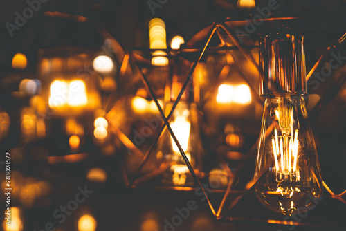 light bulbs and chandeliers in the dark