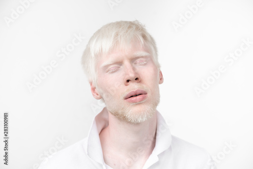 portrait of an albino man in  studio dressed t-shirt isolated on a white background Canvas Print