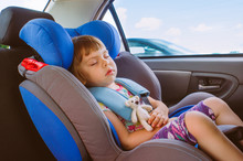 Toddler Little Girl Sleeping In The Car Seat