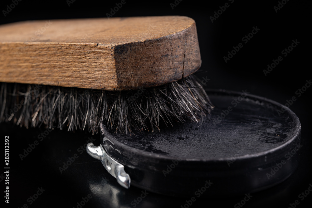 Fototapety, obrazy: Black shoe polish, brush and shoes on the table. Accessories for cleaning leather footwear.