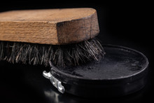 Black Shoe Polish, Brush And Shoes On The Table. Accessories For Cleaning Leather Footwear.