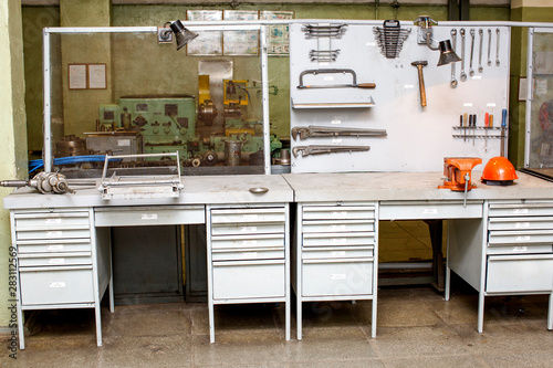 Obraz Old mechanical workshop - workbench with stand for hand tools - fototapety do salonu