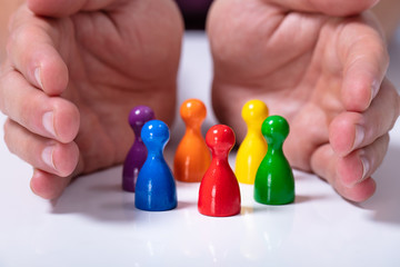 Person Protecting Multicolored Pawns