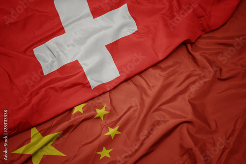 Poster Pekin waving colorful flag of china and national flag of switzerland.
