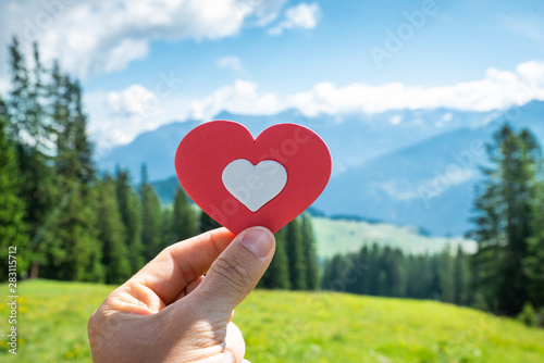 Person Holding Heart In Mountains Canvas Print