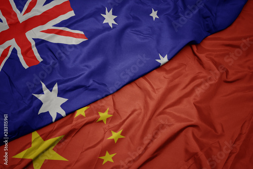 Fototapeta waving colorful flag of china and national flag of australia.