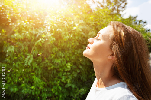 Young Woman Breathing Fresh Air Wallpaper Mural