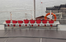 Fire Buckets And Lifebuoy On The Deck Of The Ship