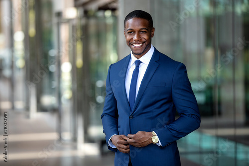 Handsome charming cheerful african american businessman in swanky modern stylish Fototapet