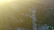 Aerial, Tracking, Drone Shot, Panning Around The Vermont Canyon Road, Buildings And The Park, Near The Griffith Observatory And Mount Hollywood, On A Sunny, Summer Day, In Los Feliz, Los Angeles, USA