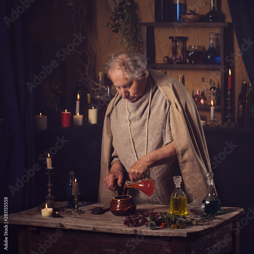 Photo  elderly alchemist monk brews  magic potion