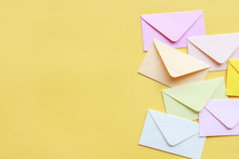 Colorful Envelopes On Yellow B...
