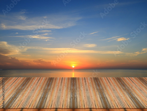 Foto auf Leinwand Blaue Nacht Wood table top on sunset background