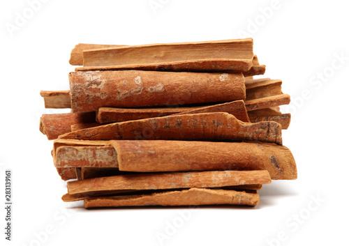 Fotografia  Cinnamon on a white background